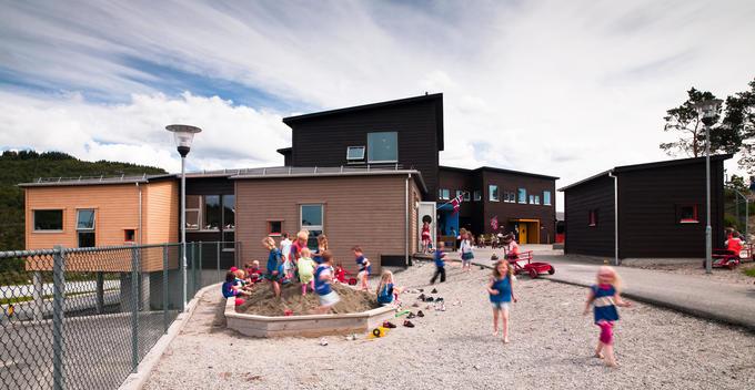 Children playing at play school nursery designed by Link Arkitektur, Bergen, Norway.