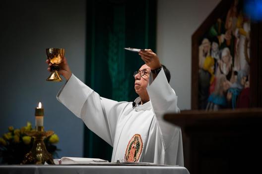 Priest giving sermon in Catholic church