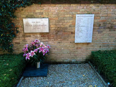 The famous Peggy Guggenheim with her favorite dogs buried at her museum in Venice Italy.