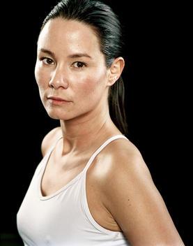 Portrait Of Confident Athletic Woman