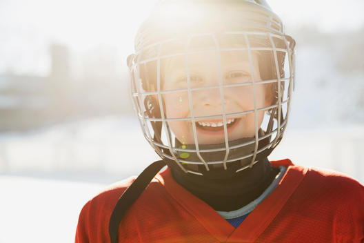 Portrait of smiling boy in ice hockey helmet
