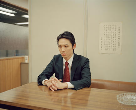 Man sitting alone in a waiting room in Tokyo, Japan.