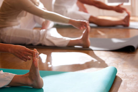 People practicing yoga close up