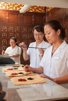 Chinese women in traditional pharmacy