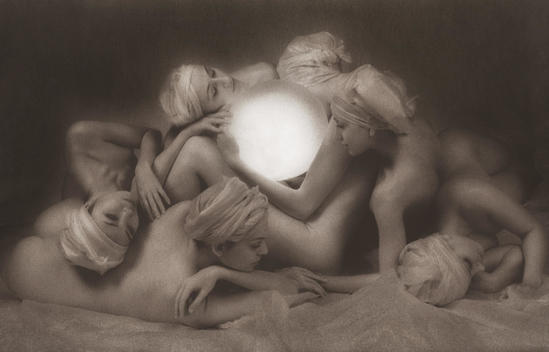 Six anonymous nude women surrounding a large luminous lit globe, some obscured with only heads revealed