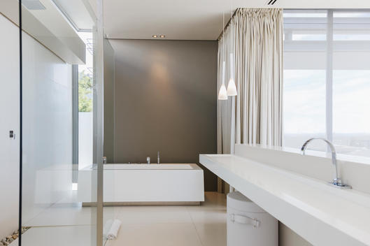 Sink and bathtub in modern bathroom