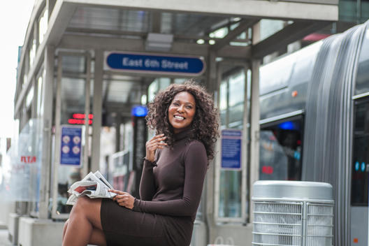 Woman waiting for public transportation