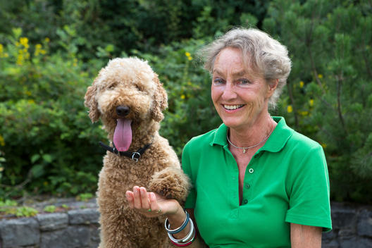 Portrait of happy senior woman and her dog