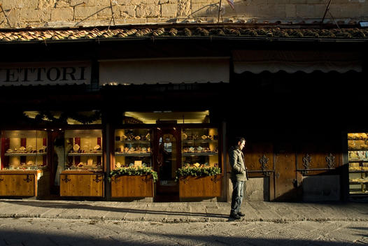 Man Crossing The Ponte Vecchio In Front Of Jewelry Store