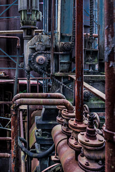 Pipes and chain drive in a disused melt shop