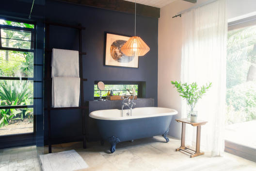 Bathtub and light fixture in modern bathroom