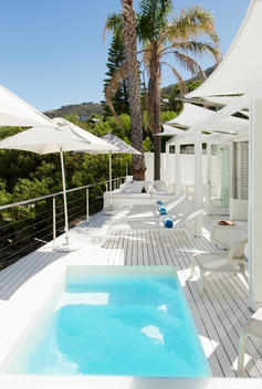 Swimming pool and lounge chairs on patio