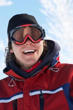 Caucasian man wearing ski goggles