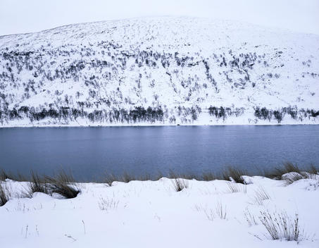 Landscape Of Snowy Lake And Hill, Scottish Highlands