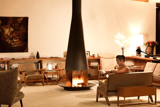 woman reading a book in the launch area of a luxury resort