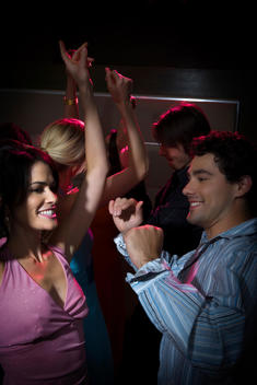 young man and woman dance at the night club