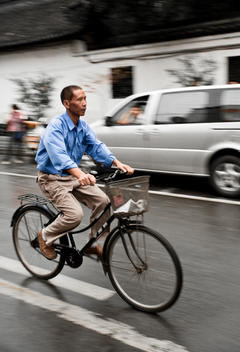 Chinese Man On Bicycle
