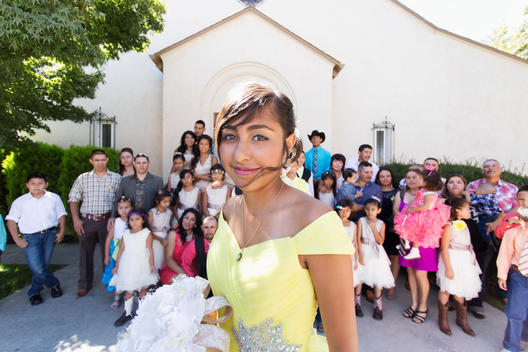 Hispanic community celebrating quinceanera outside Catholic church