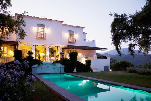 Luxury lap pool and villa at dusk