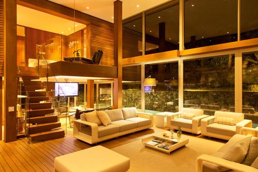 Illuminated modern living room at night