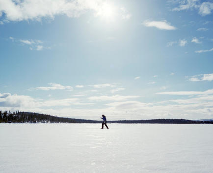 A person cross country skiing on a beautiful winter day.