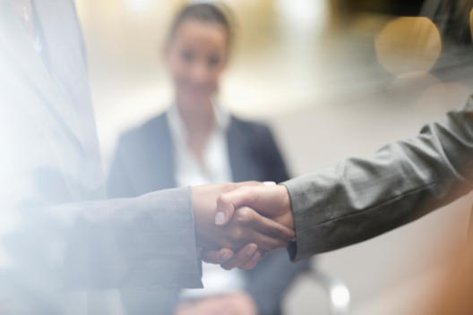 Close up of business people handshaking