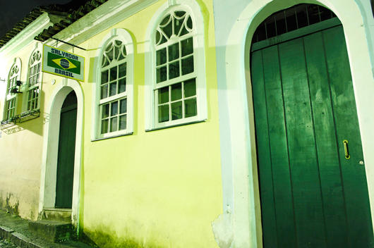 Traditional Colonial Architecture, Yellow Walls, Green Doors And Brazilian Flag