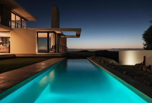Modern pool illuminated at night
