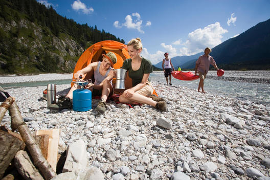 Germany, Bavaria, T_lzer Land, Young friends camping