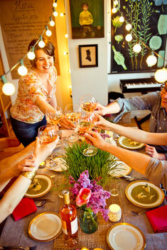 guests cheer at dinner party