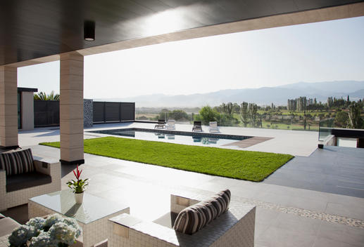 Luxury patio overlooking swimming pool and mountains
