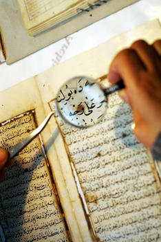 The Technician Who Takes Care Of The Ancient Islamic Holly Book Of Quran In The Suleymaniye Library.