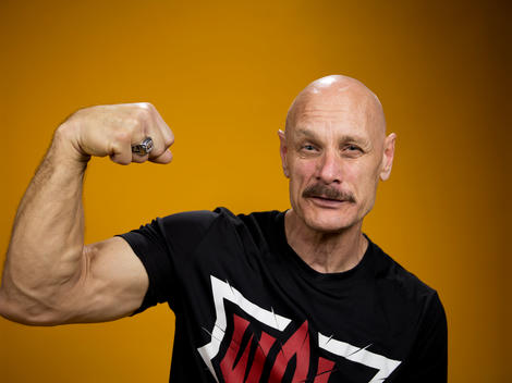 Arm wrestling competitor Allen Fisher flexes his muscles