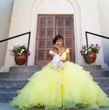 Hispanic girl celebrating quinceanera outside Catholic church