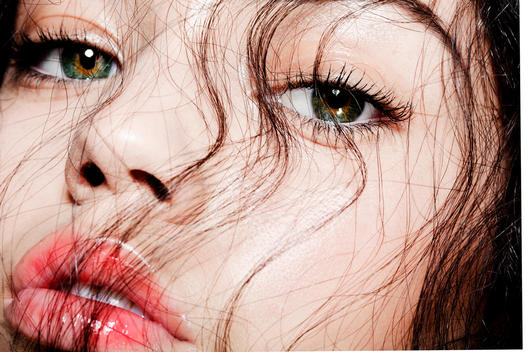 Beauty close of a young models face covered with a web of dark hair