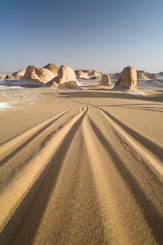 Jeep Tracks Leading To Rock Formations At The Entrance To The White Desert