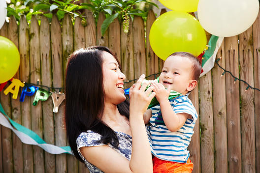 Mother and son at birthday party laughing