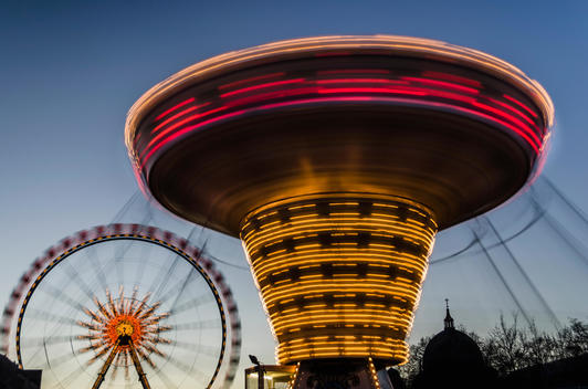 Time lapse view of carnival rides