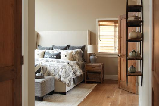 A bright and modern bed room designed with style featuring patterns.