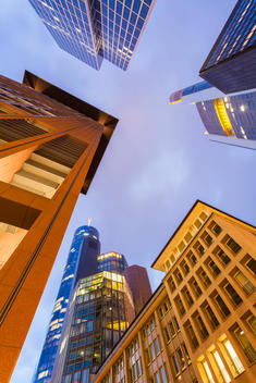 Germany, Hesse, Frankfurt, view to facades of modern office buildings from below at twilight