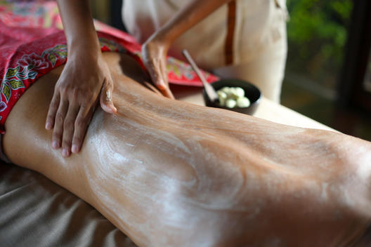 Woman receiving herbal body-scrub massage, Silvadee Resort, Thailand
