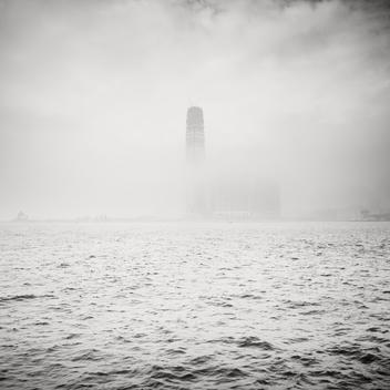 International Commerce Centre Skyscraper Rising Through Low Fog