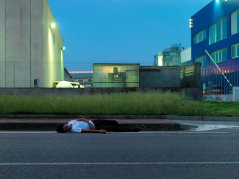 Man Sleeping On Side Of Road
