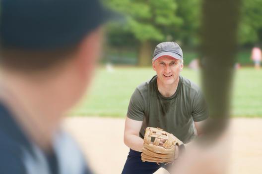 Caucasian men playing baseball on field