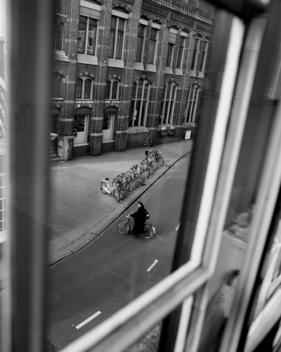 Figure On Bicycle Seen From Window.