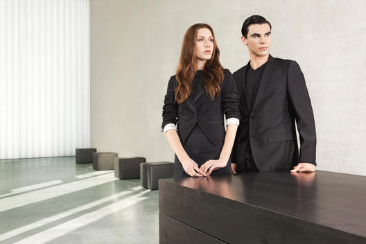 Fashion Portrait Of Two People in Business Attire.