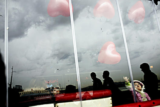 Small Children Is Touching A Heart Shaped Balloons On The Valentine Day`S In Istanbul In A Small Restaurant.