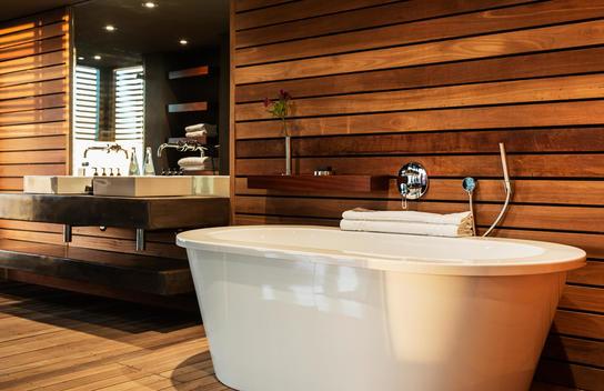 Bathtub and sink in modern bathroom