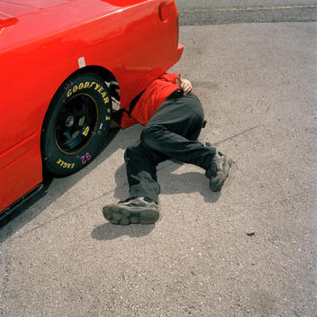 Mechanic Works On Race Car