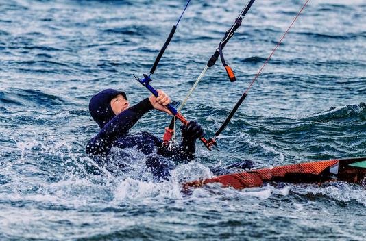 Man kitesurfing in Iceland in winter